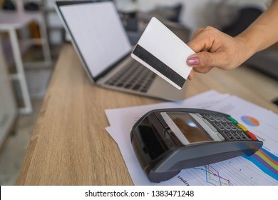 Business woman using her credit card to made a payment with EDC machine.