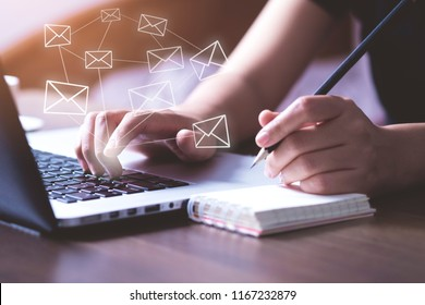 Business woman using Laptop pc to send e- mail with email icon, E-mail and communication concept.