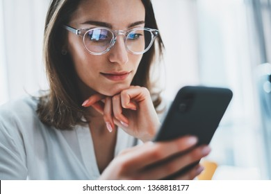 Business woman using mobile phone at working day in office.Blurred background. Business Technology Communications Mobility