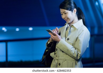 Business woman using mobile phone, directions, application