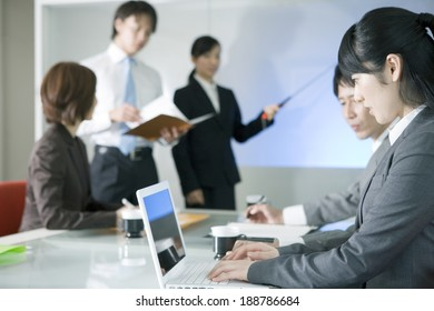 business woman using PC during meeting