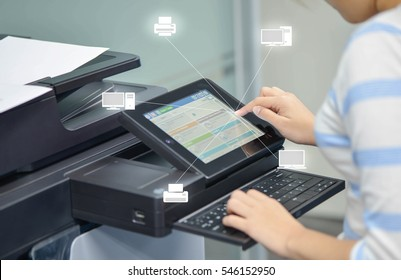 Business woman is using the printer to scanning document to network folder with icon of printer and computer