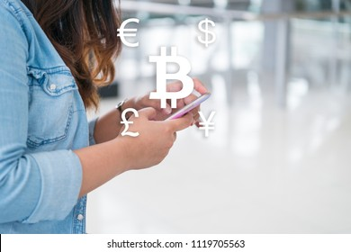 Business woman using smart phone for online money transfer, money exchange and pay rent with Bitcoin to international money. Business technology lifestyle concept of new generation of nomad workers.