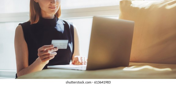 Credit card woman images stock photos vectors shutterstock business woman waiting for confirmation of her online order at home blogger shopping online and reheart Choice Image