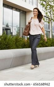 Business Woman walking on boardwalk