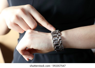 business woman watching and pointing to the wrist watch