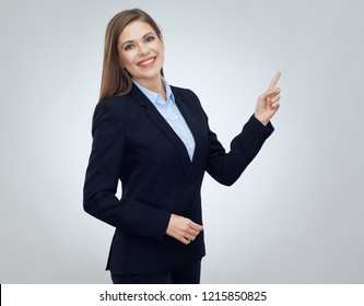 Business woman wearing black suit pointing finger at copy space. Isolated studio portrait.