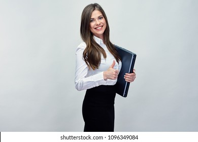 Business woman wearing office dress code holding laptop and showing thumb up. Isolated studio portraot.