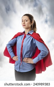 business woman wearing a super hero cape