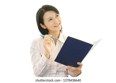 Business woman who checks the schedule.