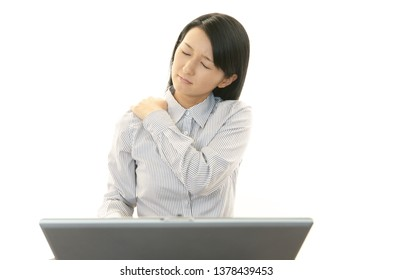 Business woman who has a shoulder pain.