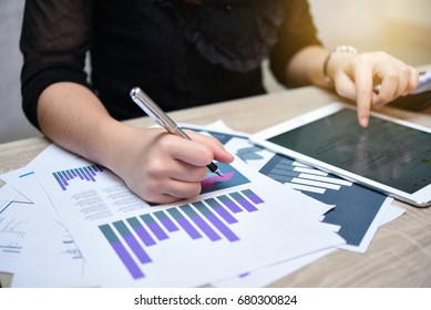 business woman work with tablet and business graph