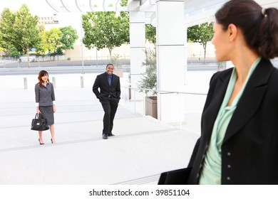 A business woman at work waiting for her co-workers