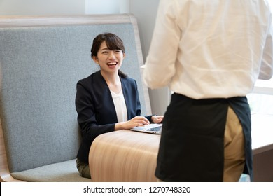 Business woman working at a cafe