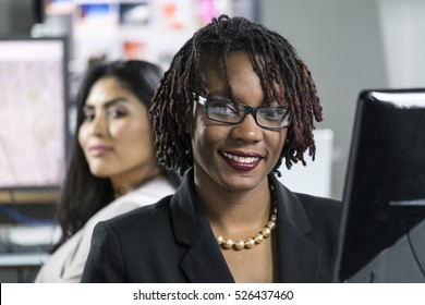 Business woman working at her computer in an office