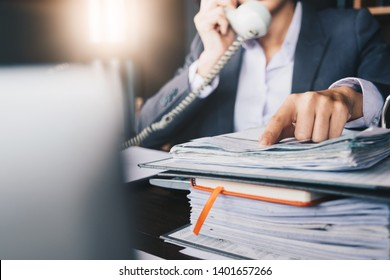 Business woman working at her office during talking on phone for financial analysis - Business Concept
