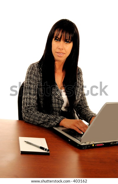 Business woman working at a laptop computer
