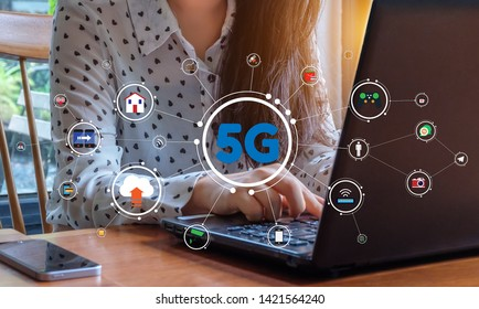 Business woman is working with laptop over 5G internet. 5G network illustration graphic.