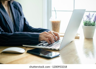 Business woman working in office with documents and laptop. Business concept