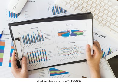 Business woman working at office with documents