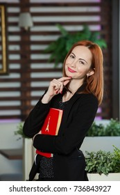 Business woman working in office with documents. Portrait of a attractive business woman at office. Portrait of woman in her office.