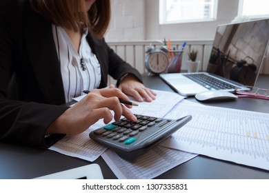 Business woman working in office with financial documents. Business concept