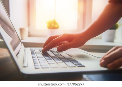 Business woman working at office with laptop