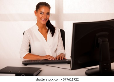 Business woman working on computer in office.