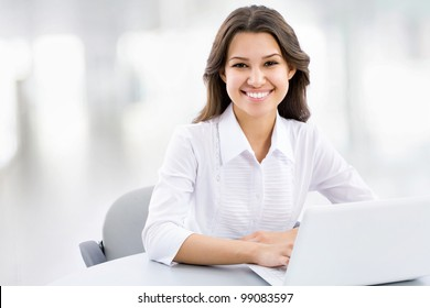 Business woman working on laptop at office