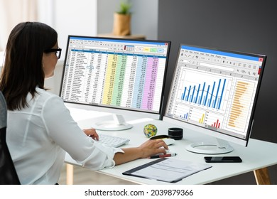 Business Woman Working With Spreadsheet Graphs On Computer