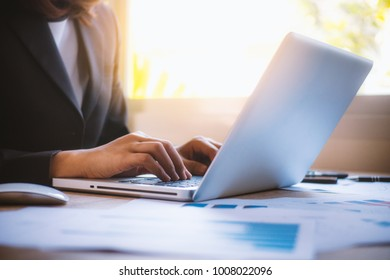 Business woman working together at office desk, hands working print the out financial data. teamwork workplace strategy Concept.