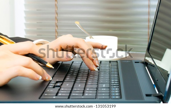 business woman at workplace with laptop