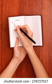 business woman writes notes for plan