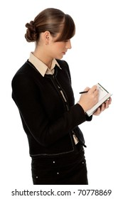 business woman writes notes for business plan