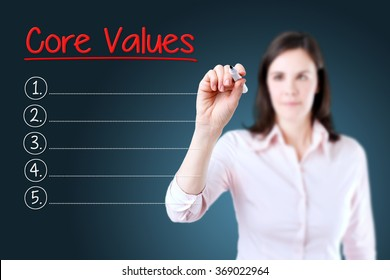 Business woman writing blank Core Values list. Blue background.