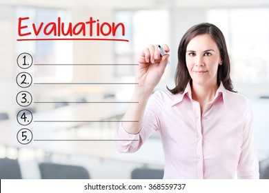 Business woman writing blank Evaluation list. Office background.