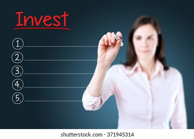 Business woman writing blank Invest list. Blue background.