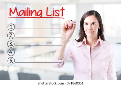 Business woman writing blank Mailing List list. Office background.