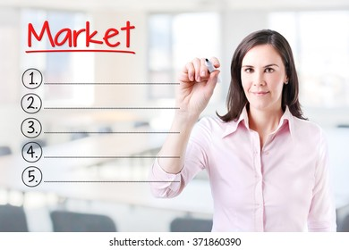 Business woman writing blank Market list. Office background.