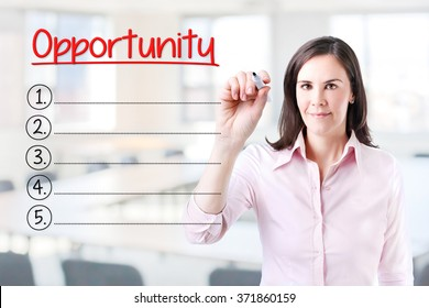 Business woman writing blank Opportunity list. Office background.