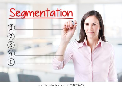 Business woman writing blank Segmentation list. Office background.