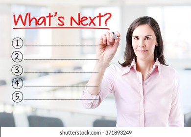 Business woman writing blank What's Next? List. Office background.