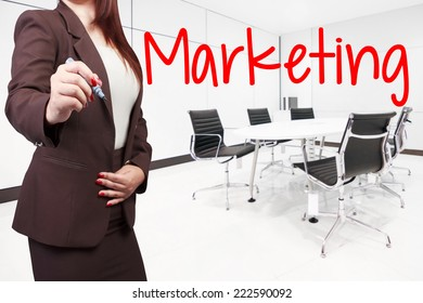 business woman writing marketing on virtual screen at conference room in modern office interior