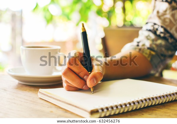 Business woman writing in notebook