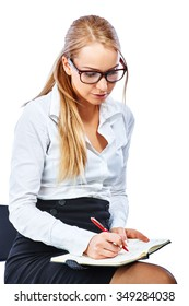 Business woman writing in a notebook. Isolated on a white background