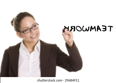 Business woman writing on transparent board