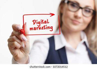 Business woman writing something with a marker or pen.DIgital marketing technology concept.