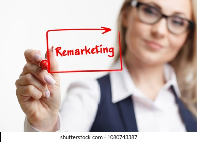 Business woman writing something with a marker or pen.Remarketing