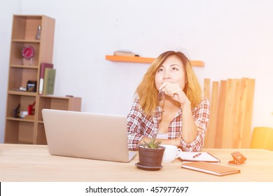 business woman writing something on notepad in office.