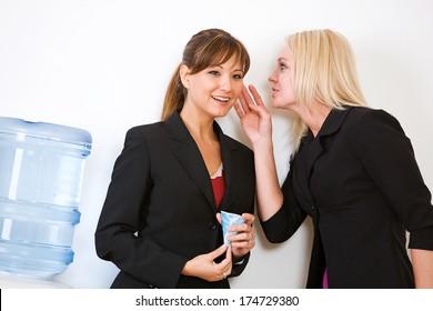 Business: Women Gossiping Around Water Cooler